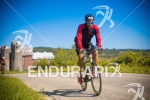 Age group athlete Chris Easley of New York enjoying the scenic areas on the bike course at the 2018 Ironman Wisconsin on September 09, 2018 in Madison, WI.