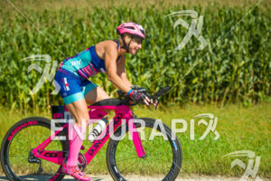 40-44 age group competitor Robin Conlon finding a smile on the bike course at the 2018 Ironman Wisconsin on September 09, 2018 in Madison, WI.