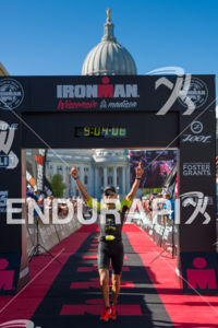 Overall winner Ryan Guliano celebrating at the finish line at the 2018 Ironman Wisconsin on September 09, 2018 in Madison, WI.