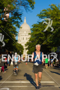 Running into the sun on State Street at the 2018 Ironman Wisconsin on September 09, 2018 in Madison, WI.