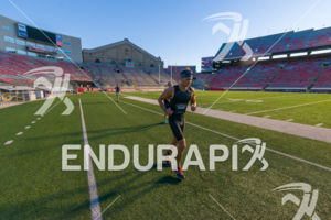 A runner digging deep  in Camp Randall Stadium on the run course at the 2018 Ironman Wisconsin on September 09, 2018 in Madison, WI.