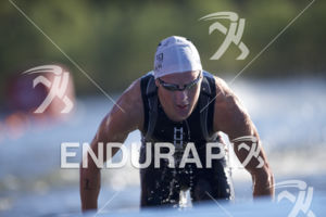Henri Schoeman completes the swim leg at the 2018 Beijing International Triathlon on September 23, 2018 in Beijing, China.