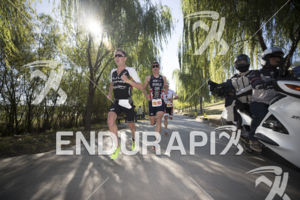 Henri Schoeman, Jonny Brownlee and Kristian Blummenfelt in the early stage of the run course at the 2018 Beijing International Triathlon on September 23, 2018 in Beijing, China.