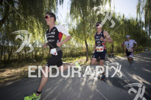 Henri Schoeman, Jonny Brownlee and Kristian Blummenfelt (left to right) in the early stage of the run course at the 2018 Beijing International Triathlon on September 23, 2018 in Beijing, China.