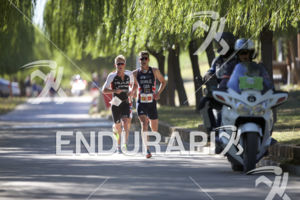 Henri Schoeman, Jonny Brownlee and Kristian Blummenfelt leading a front pack on the run course at the 2018 Beijing International Triathlon on September 23, 2018 in Beijing, China.