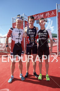 Kristian Blummenfelt, Jonny Brownlee and Henri Schoeman (left to right) at the 2018 Beijing International Triathlon on September 23, 2018 in Beijing, China.