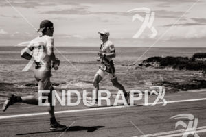 Javier Gomez Noya (ESP), (l-r), Lionel Sanders (CAN)compete during the run leg at the 2018 Ironman World Championship in Kailua-Kona, HI on October 13, 2018.