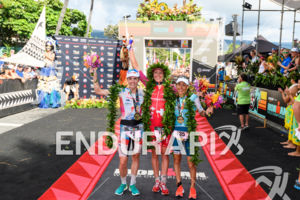 Lucy Charles (GBR) (l-r), Daniela Ryf (SUI), Anne Haug (GER) at the finish of the 2018 Ironman World Championship in Kailua-Kona, HI on October 13, 2018.