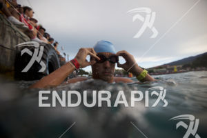 An age grouper arrives at the swim start at the 2018 Ironman World Championship in Kailua Kona, HI on October 13 2018.