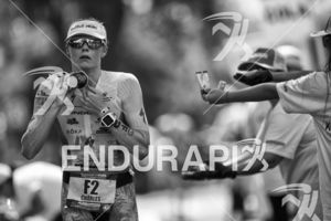 Lucy Charles cools off while passing an aid station at the 2018 Ironman World Championship in Kailua Kona, HI on October 13 2018.