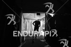 A participant leaves the transition tent at transition area 2 (T2) at the 2019 Ironman Santa Rosa triathlon held in Sonoma County, CA on May 11, 2019.