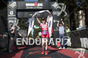 Barbara Perkins is first to cross the finish line in the women's division at the 2019 Ironman Santa Rosa triathlon held in Sonoma County, CA on May 11, 2019.