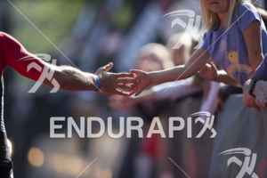 Supporters high-five finishers at the 2019 Ironman Santa Rosa triathlon held in Sonoma County, CA on May 11, 2019.