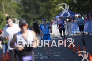 Participants on the run course in downtown Santa Rosa at the 2019 Ironman Santa Rosa triathlon held in Sonoma County, CA on May 11, 2019.