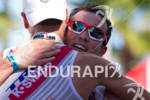 Joe Gambles embraces Michael Raelert at the finish line