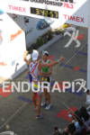 Michael Raelert and Filip Ospaly embrace at the finish line…