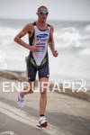 Matt Reed running at the Rohto Ironman 70.3 California in…