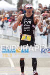 Andy Potts celebrates at the finish line at the Rohto…