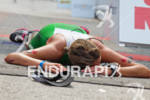 Sofie Goos takes a minute at finish line at the…