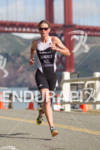 Nicky Samuels runs under the Golden Gate Bridge at the…
