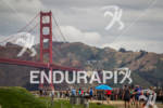 Athletes run along Chrissy Field toward the Golden Gate Bridge…