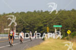 Pro men bike through the scenic Eastern Shore at the…