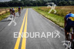 Athletes bike through the scenic fields at the Ironman 70.3…