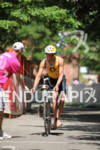 Maik Twelsiek enters T2 at the 2011 Ford Ironman Coeur…