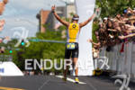 Maik Twelsiek salutes crowd at finish - 2011 Ford Ironman…