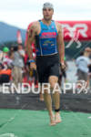 Tim Snow exits water at the 2011 Ford Ironman Lake…