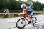 Jason Shortis on bike at the 2011 Ford Ironman Lake…