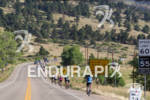 Age group athletes heading out on the bike course at…