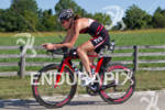 Donna Phelan (CAN) races down the road on her Trek…