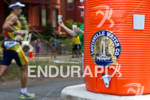 Athletes run through aid station at the 2011 Ford Ironman…
