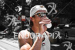 Age Group athlete Tom Goth (USA) goes through aid station…