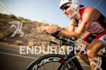Craig Alexander on bike competing at the Ironman World Championship…