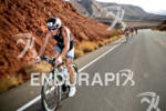 Luke McKenzie pulls away on bike competing at the Ironman…