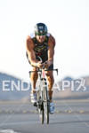 Raynard Tissink (RSA) on the bike at the Marines Ironman…