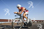 Craig Alexander (AUS) on the bike at the Marines Ironman…
