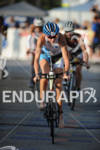 Leanda Cave competing in the bike portion of the 2011…
