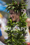 Craig Alexander celebrates his finish at the 2011 Ford Ironman…