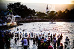 Age group athletes line up in the water getting ready…