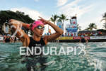 Female age group athlete preparing for the swim start of…