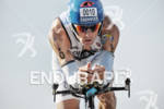 Andreas Raelert competing in the bike portion of the 2011…