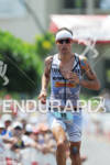 Andreas Raelert at Hot Corner running up Palani Road after…