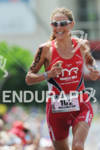 Chrissie Wellington competing in the run portion of the 2011…