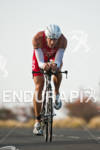 Andy Potts (USA) competing in the bike portion of the…