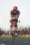 Ben Hoffman (USA) competing in the bike portion of the…