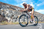 Faris Al-Sultan (GER) competing in the bike portion of the…