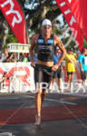 Mike Aigroz in the swim to bike transition of the…
